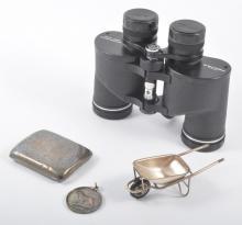 Silver cigarette case, silver medal, white metal miniature wheelbarrow, and
