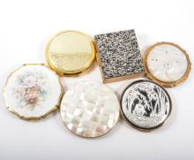A collection of sixteen powder compacts,
