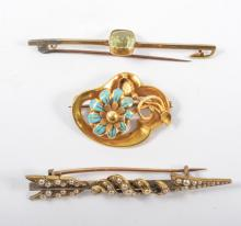 Three vintage brooches, a seed pearl arrow brooch 60mm long, a turquoise fl