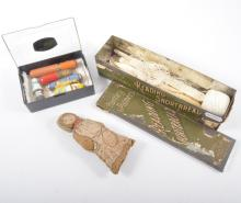 A small number of sewing requisites, two enamel and two other cotton holder