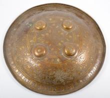An antique Indian shield, Dhal, foliate engraved brass, 36cms diameter.