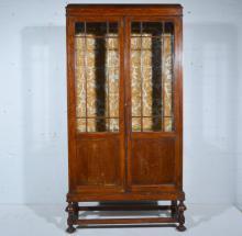 Oak display cabinet, two glazed panelled doors, W90cm x D32cm x H177cm.