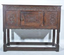 Joined oak credence cupboard, rectangular boarded top, lunette carved friez