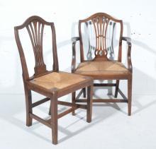 Set of five late Georgian oak dining chairs, arched backs, pierced vase sla