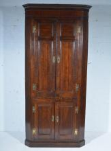 Victorian oak free-standing corner cupboard, dentil and cavetto moulded cor