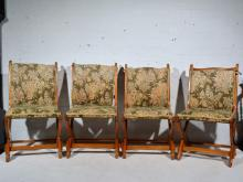 Set of four oak framed Arts and Crafts style chairs, in need of re-upholste