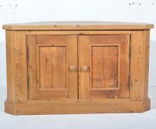 Pine corner TV stand, with panel cupboard doors, W100cm x D56cm x H59cm.