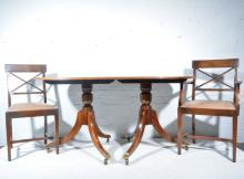 Mahogany twin pedestal dining table, D-shaped ends with one additional leaf