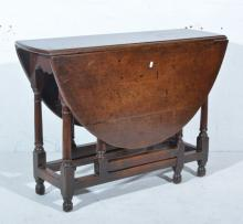 Small joined oak gateleg table, oval top with two fall leaves, turned legs,