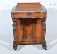 Victorian oak Davenport, the pen box above a slope writing surface, carved