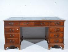 Reproduction mahogany desk, Georgian style, rectangular top with a leather