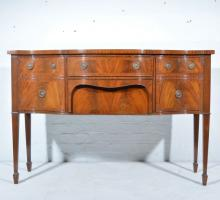 Sheraton style mahogany sideboard, serpentine outline, with cross banding a