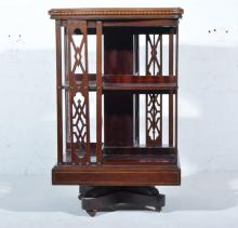 Victorian inlaid mahogany revolving bookcase, serpentine outline, inlaid ar