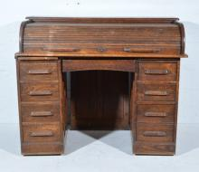 Oak roll-top desk, curved tambour enclosing fitted interior, twin pedestals