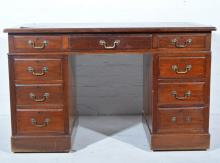 Edwardian walnut twin pedestal desk, nine drawers surrounding the kneehole,
