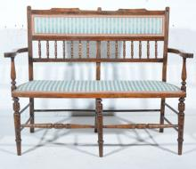 Victorian walnut double chair back settee, the back with turned and ringed