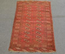 Persian rug, red field with Tekke guls, two rows of eleven guls, enclosed b