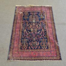 Iranian rug, navy field with stylised foliate design enclosed by multiple s
