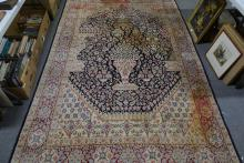 Kirman Persian pattern rug, with a formal decoration on an urn, flowers, wi