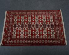 Kilim / Persian rug, with three rows of six guls joined by poles, against a