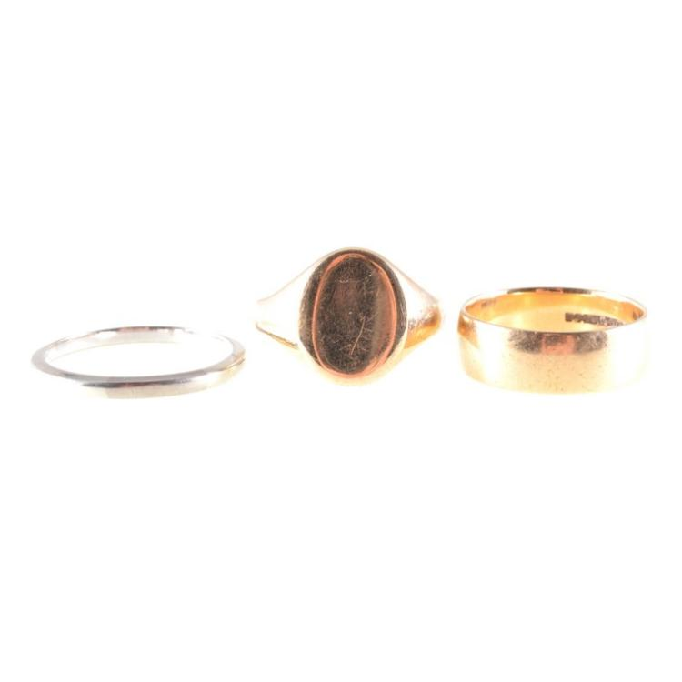 three gold rings an 18 carat white gold wedding band 2 1mm