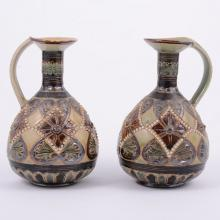 Doulton Lambeth, a pair of stoneware ewers, 1885, incised and beaded design