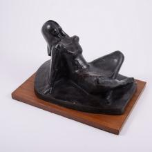 Wendy MacPherson,  reclining female,  patinated composition sculpture, hard