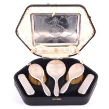 Seven-piece silver-backed dressing table set, London 1919, engraved decorat