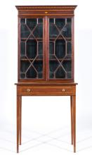 Edwardian mahogany bookcase, simulated dentil and cavetto moulded cornice,