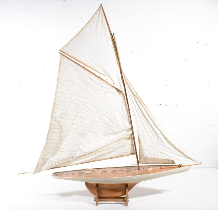 Columbia model yacht on stand, 123cm long.