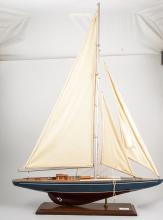A model pond yacht, integral stand, 87cm high, 62cm wide.