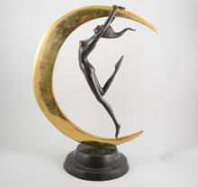 A patinated bronze and polished brass figural sculpture, with a nude female