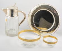 A silver coloured cigarette/jewel box, mirror in a plain silver coloured fr