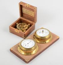 A set of balance scales, bearing a label ''Albertoni Silvio milano'', a bra