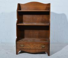 Reproduction mahogany open bookcase of small size, two shelves over a singl