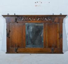 Edwardian oak hall mirror, rectangular central plate below a pierced scroll