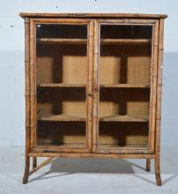 An early 20th century bamboo and rattan work glazed bookcase, with two fixe