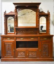 Victorian walnut mirror-back sideboard, arched pediment, the back with beve