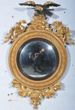 Regency gilt framed mirror, eagle surmount, convex glass, height 82cm.