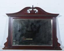 Edwardian red walnut overmantel mirror, broken swan neck and urn pediment,
