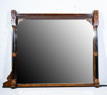 Large Victorian Gothic Revival oak and ebonised overmantel mirror, in the m