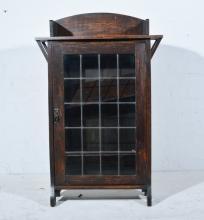 Edwardian oak bookcase, single glazed door, W67.5cm x D24cm x H104cm.