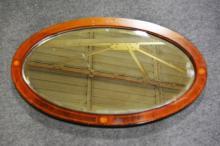 Edwardian inlaid mahogany oval mirror.
