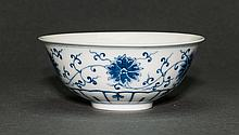 Qing. A Blue And White Floral scroll Bowl