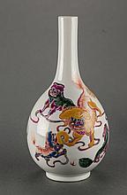 Qing. A Famille-Rose Glaze Fu Dog's Vase