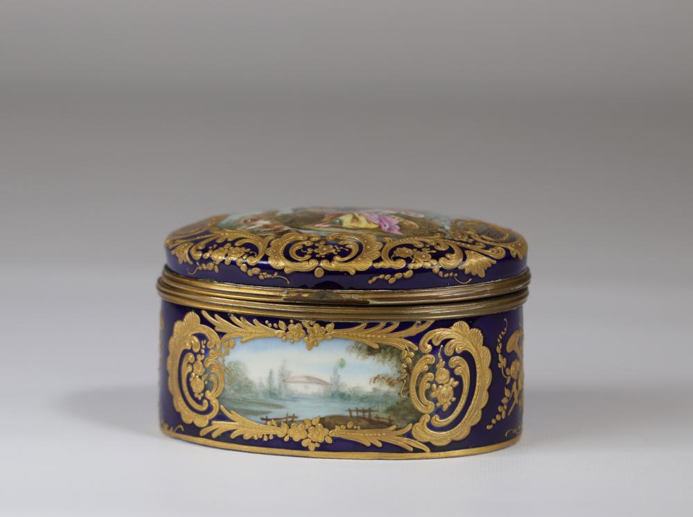 Sevres porcelain covered box painted with romantic scenes Sizes: H=80mm L=135mm Weight (K)