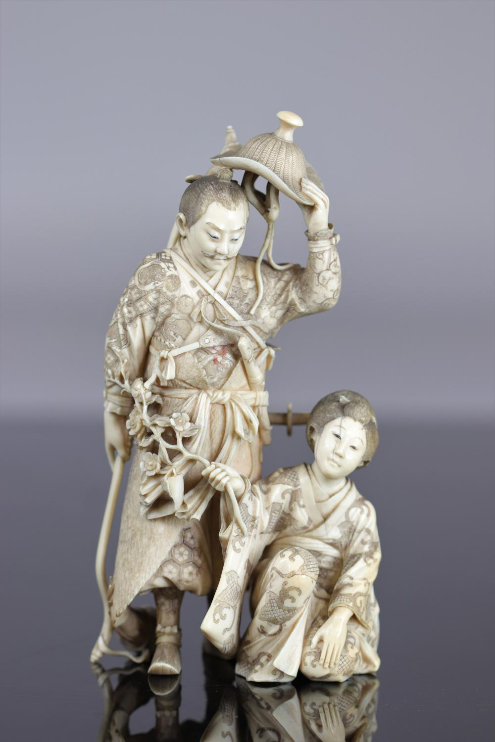 Japan imposing Okimono carved of a warrior and a young woman 19th Sizes: H=190mm L=100mm W