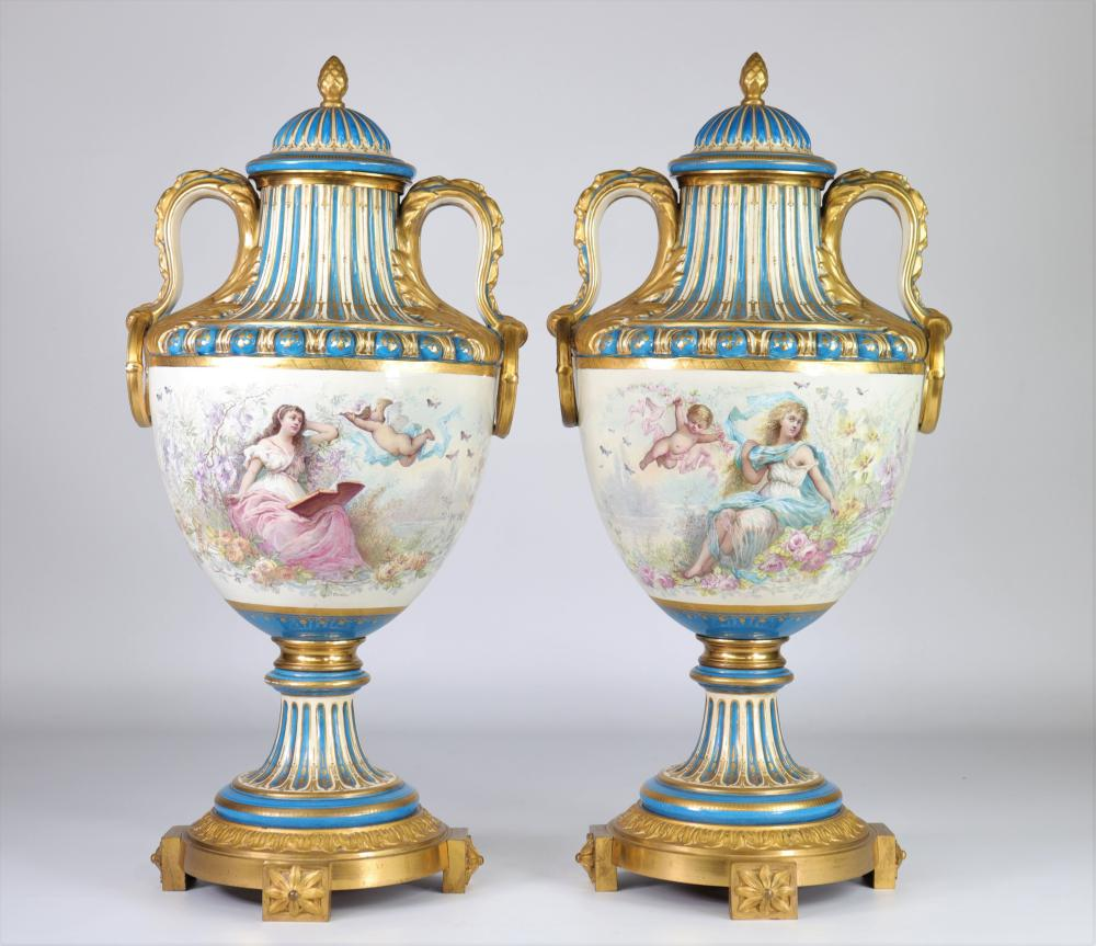 Sevres pair of monumental vases mounted on gilded bronze, painted with romantic scenes, the reverse