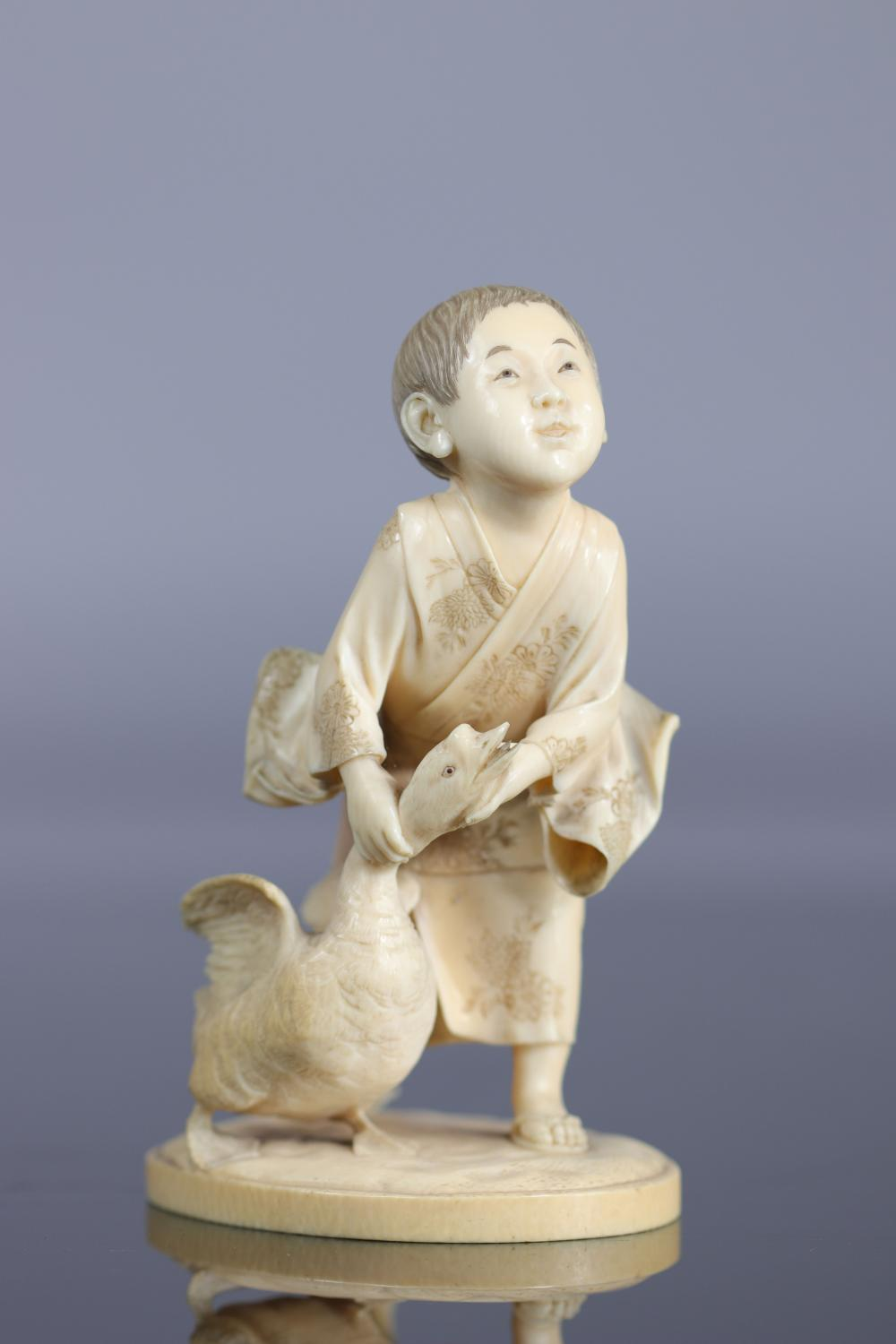 Japan Okimono carved of a young boy with a goose 19th Sizes: H=140mm L=90mm Weight (K): 0,