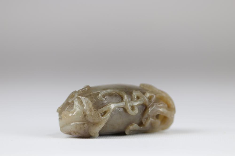 Jade brush rest, in the shape of a fruit, Qing dynasty China Sizes: H=30mm L=75mm l=50mm W